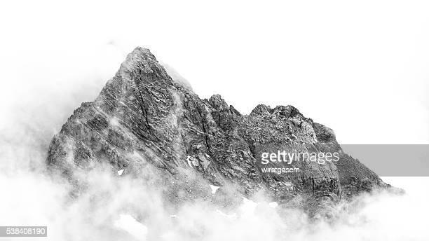 Snow mountain seen through clouds