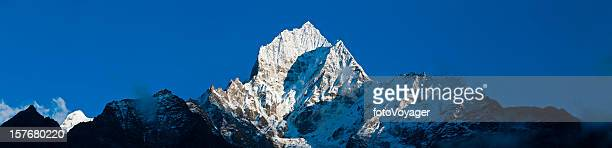 Snow mountain summit dramatic peaks pinnacles panorama Thamserku Himalayas Nepal