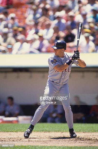 T Snow of the California Angels bats during the game against the Oakland Athletics at OaklandAlameda County Coliseum on June 29 1994 in Oakland...