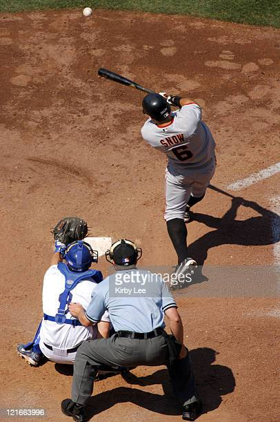 JT Snow of the San Francisco Giants bats as umpire Adam Dowdy and Los Angeles Dodgers catcher Jason Phillip watch The Giants beat the Dodgers 41 in...