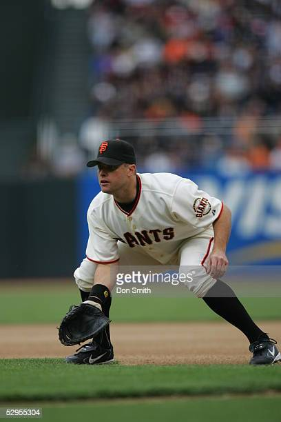 T Snow of the San Francisco Giants fields during the game against the San Diego Padres at SBC Park on April 27 2005 in San Francisco California The...
