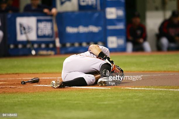 T Snow of the San Francisco Giants lies on the field after being hit by a pitch against the Minnesota Twins during the game on June 15 2005 at the...
