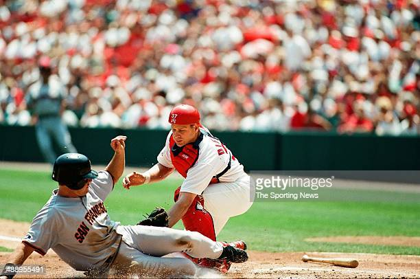 T Snow of the San Francisco Giants slides against the St Louis Cardinals at Busch Stadium on July 19 1997 in St Louis Missouri The Cardinals beat the...