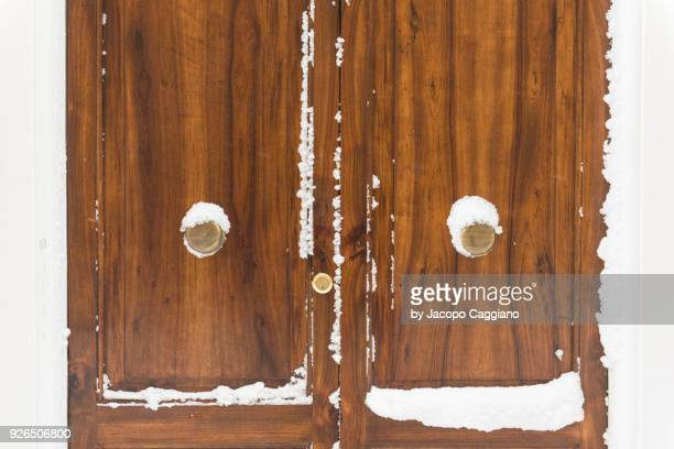 Snow on a closed wooden door