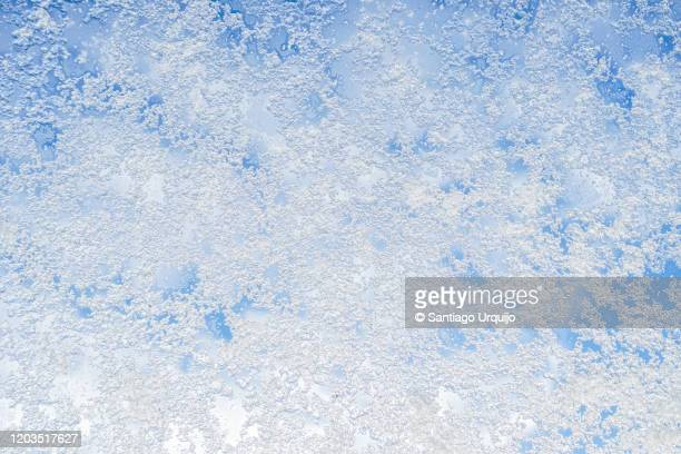 snow on a window - frost stock pictures, royalty-free photos & images