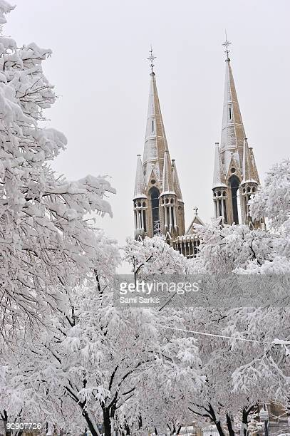 snow on bell towers and trees, reformes church, - 2009 stock pictures, royalty-free photos & images