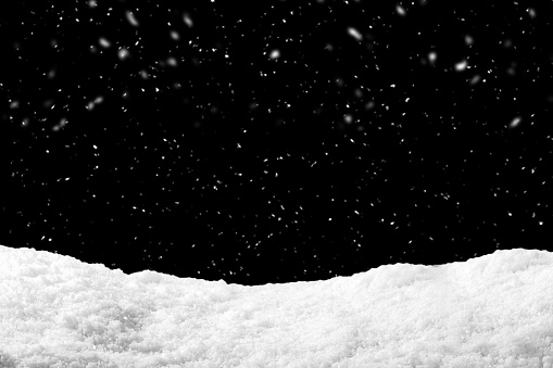 Snow on black background with snowfall. Snowdrift backdrop in winter season. 1062831302