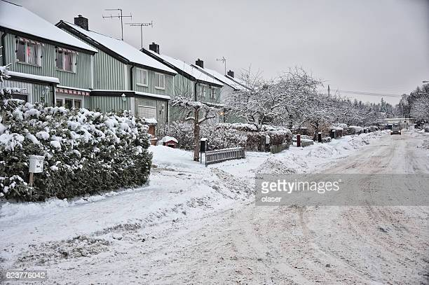Snow on houses and car
