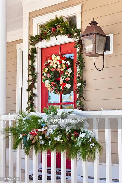 snow on porch with christmas decorations - porträt bildbanksfoton och bilder