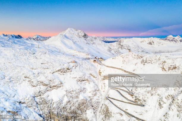 snow on stelvio pass mountain road, aerial view, bormio, lombardy, italy - ボルミオ ストックフォトと画像