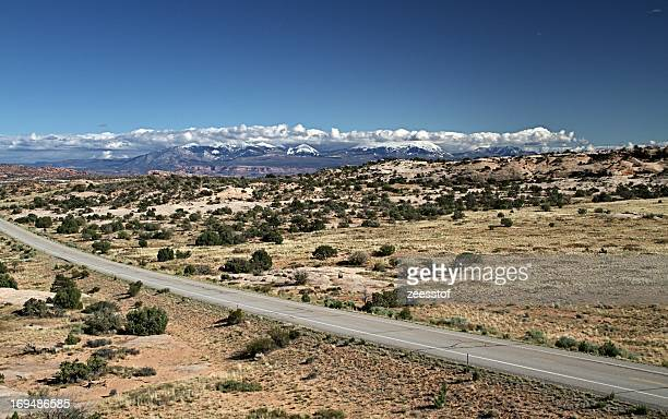 snow on the la sal peaks - zeesstof stock pictures, royalty-free photos & images