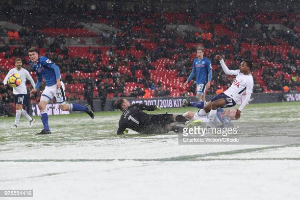 Snow on the pitch at Wembley as Kyle WalkerPeters of Tottenham Hotspur scores their 6th goal during the Emirates FA Cup Fifth Round Replay match...