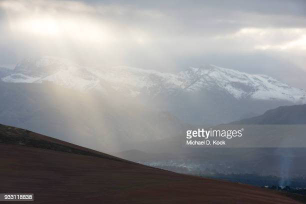 snow on the riviersonderend mountains above the villages of genadendal and greyton, setting sun with spectacular light, overberg, western cape - overberg stock pictures, royalty-free photos & images