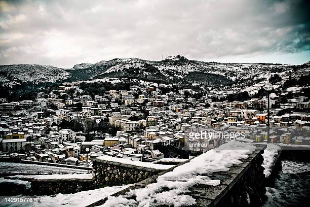 snow on village - annfrau stock pictures, royalty-free photos & images