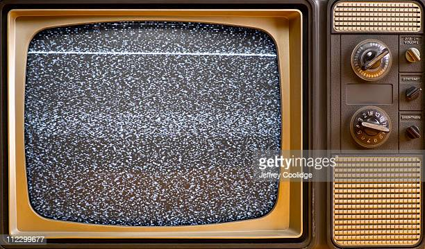 """""""snow"""" on vintage tv screen - white noise stock photos and pictures"""