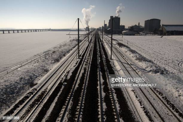 TOPSHOT Snow partially covers railway tracks outside Artenay near Orleans some 120 km south of Paris on February 8 2018 / AFP PHOTO / CHRISTOPHE...