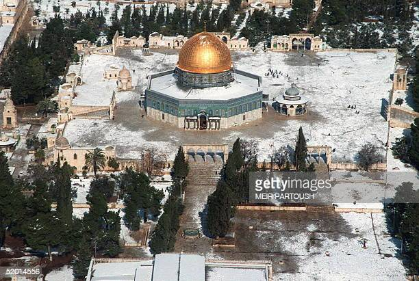Snow partly covers the Dome of the Rock and the alAqsa mosque coumpound the third holy place of Islam in Jerusalem's Old City 12 January A thick...
