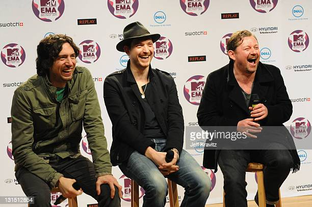Snow Patrol with Gary Lightbody, Nathan Connolly and Tom Simpson attend a MTV Europe Music Awards 2011 press conference at Odyssey Arena on November...