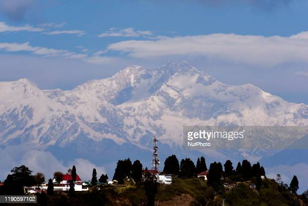 Snow peak Kangchenjunga mountain range can be seen in a hilly place of North Bengal, India, 24 December, 2019.