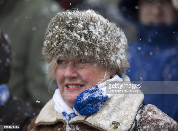 Snow peppers a spectator during the English Premier League football match between Stoke City and Everton at the Bet365 Stadium in StokeonTrent...