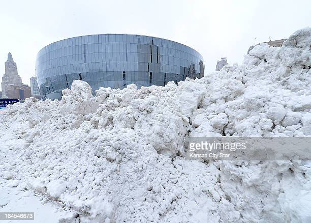 Snow piled up from the street sits in front of the Sprint Center in Kansas City Missouri after heavy snow fell Sunday March 24 2013 The Sprint Center...