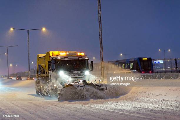 snow plough at dusk - snowplow stock pictures, royalty-free photos & images