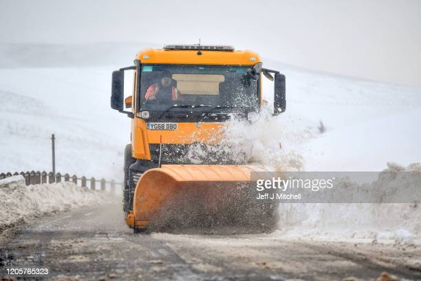 A snow plough clears drifting snow on the B797 on February 12 2020 on Wanlockhead Scotland A yellow warning for snow and ice remains in place across...