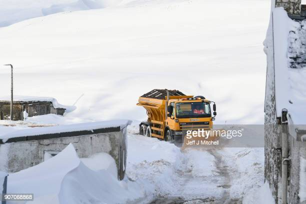 A snow plough clears roads as the Met Office upgrades its weather warning across the country on January 19 2018 in Wanlockhead Scotland Forecasters...
