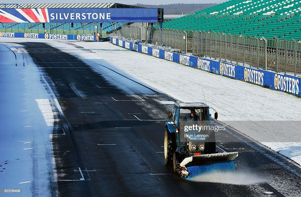 A snow plough clears the track for Formula One Testing at Silverstone Circuit on February 22, 2005 in Silverstone, England.