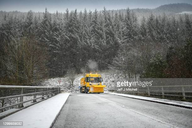 Snow plough grits the M74 as significant snowfall is being forecast on February 02, 2021 in Abington, Scotland. The Met Office have issued warnings...
