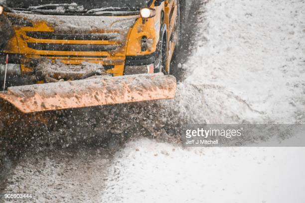 A snow plough makes at way south on the M74 following motorist spending the night stranded on the motorway on January 17 2018 in Abington Scotland...