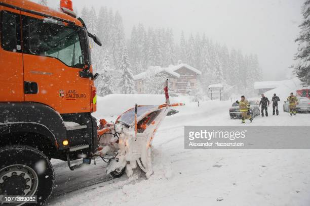 A snow plow cleans the main road out of a valley that was blocked after heavy snow falls on January 5 2019 in Filzmoos Austria Filzmoos is a town...