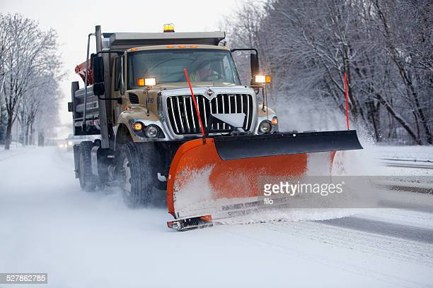 snow plow clearing the road - snowplow stock pictures, royalty-free photos & images