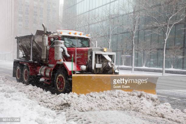 A snow plow clears a road as Winter Storm Skylar bears down on March 13 2018 in Boston MassachusettsThis is the third nor'easter to hit the area in...