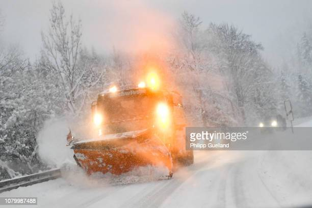 A snow plow clears a road on January 10 2019 near GarmischPartenkirchen Germany Exceptionally high levels of snow have closed roads and ski resorts...