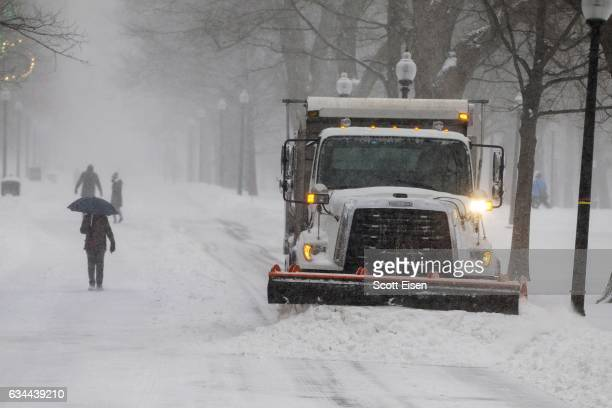A snow plow clears an area in the Boston Common as a winter storm bears down on February 9 2017 in Boston United States A snowstorm has been forecast...