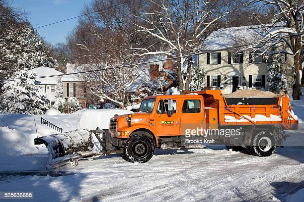 A snow plow clears residential streets after a snow storm in Bethesda MD