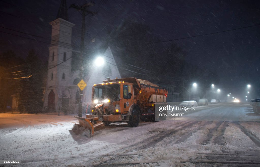 A snow plow clears snow from the road in the Bronx Borough March 14, 2017 in New York. Winter Storm Stella dumped snow and sleet Tuesday across the northeastern United States where thousands of flights were canceled and schools closed, but appeared less severe than initially forecast. After daybreak the National Weather Service (NWS) revised down its predicted snow accumulation for the city of New York, saying that the storm had moved across the coast. EMMERT