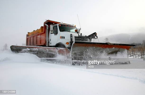 A snow plow clears the Hami section of Xinjiang 303 provincial road on November 16 2011 in Hami China Heavy snows have swept northern parts of...