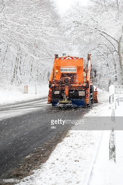 snow plow truck - bad road conditions, heavy snowfall - road salt stock pictures, royalty-free photos & images