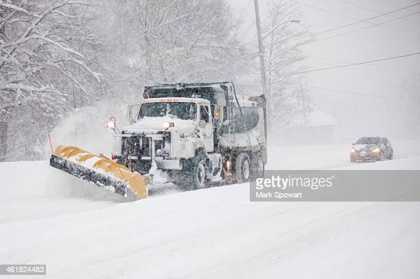 CONTENT] A snow plow works at clearing streets in London Ontario Canada on November 24 2013 The city and region received more than 60cm of snow in...