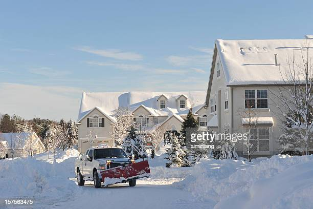 snow plowing truck in action - snowplow stock pictures, royalty-free photos & images