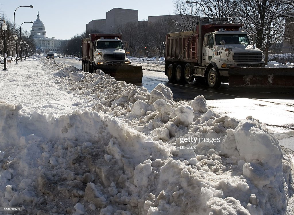 Snow plows spread salt and sand on Pennsylvania Ave. NW on Monday, Feb. 8, 2010, following the weekend's historic snowstorm.
