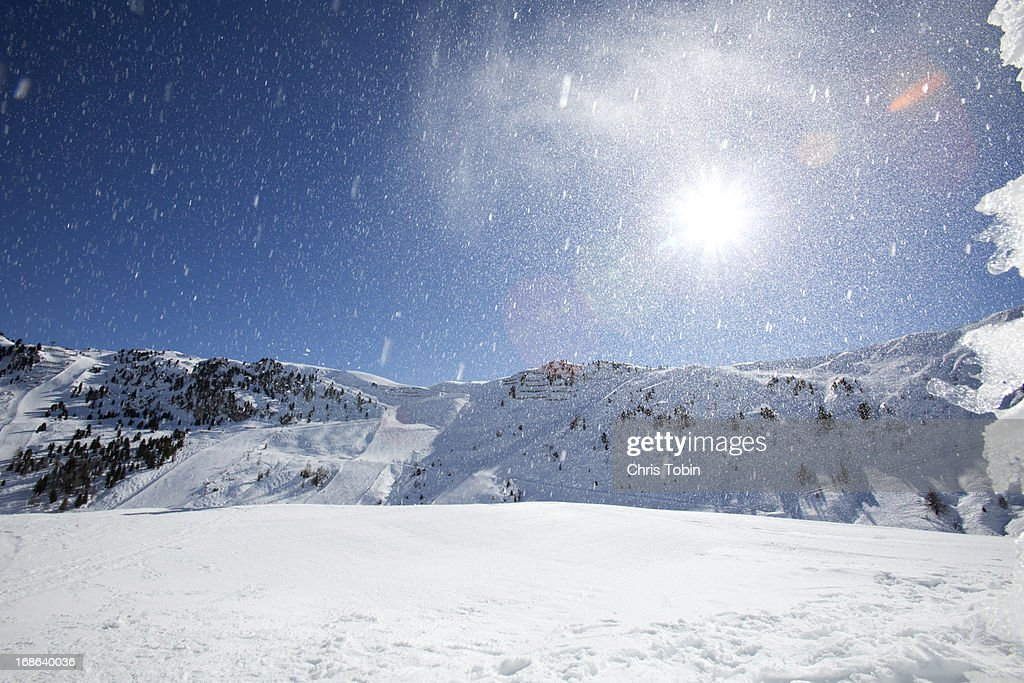 Snow powder in the sky : Stock Photo