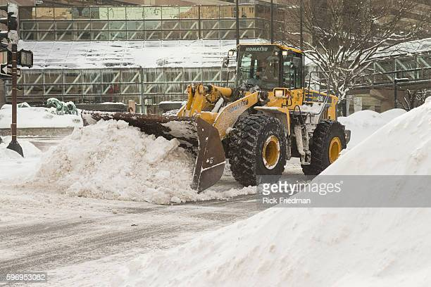 Snow removal on Dartmouth St in Boston MA where over 7 feet of snow has fallen in past 3 weeks on February 15 2015