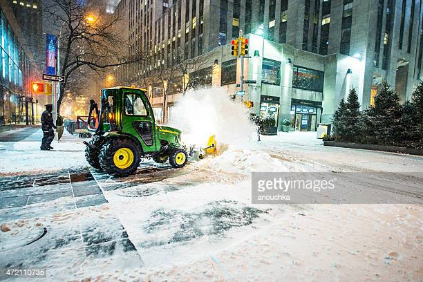 snow removal on new york street during snowfall - snowplow stock pictures, royalty-free photos & images