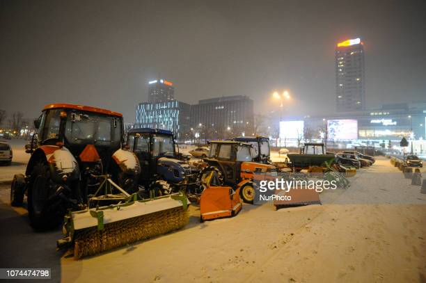 Snow removal vehicles are seen in the center of Warsaw Poland on December 20 2018 Poles this year will spend on average 6 percent more on Christmas...