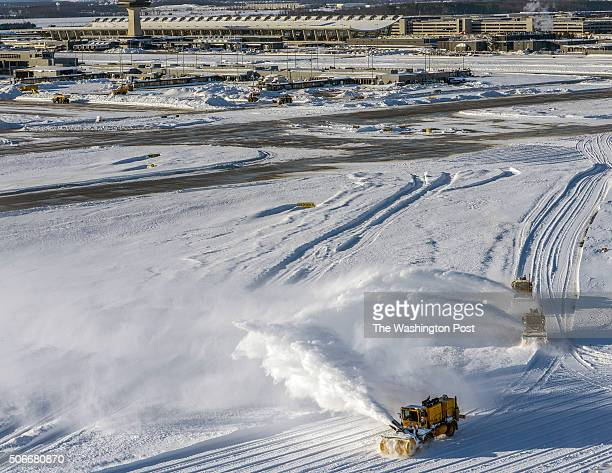 Snow removers clear the runways at Dulles International Airport in the aftermath of the big blizzard on January 2016 in Dulles VA