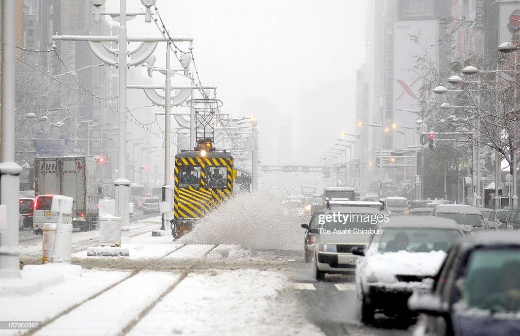 A snow removing tram runs in Sapporo City for the first time of the season on November 27, 2012 in Sapporo, Hokkaido, Japan. 41,000 households in Hokkaido lose power due to the heavy snow.