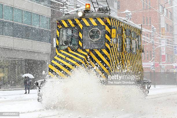 A snow removing tram so called 'Sasara Densha' runs in Sapporo City for the first time of the season on November 24 2015 in Sapporo Hokkaido Japan...